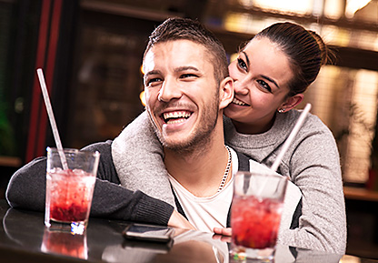 Couple Sitting at Bar with Cocktails
